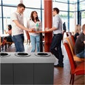 The Alpine 471-02-BLK Recycling Center in use in a commercial cafeteria.